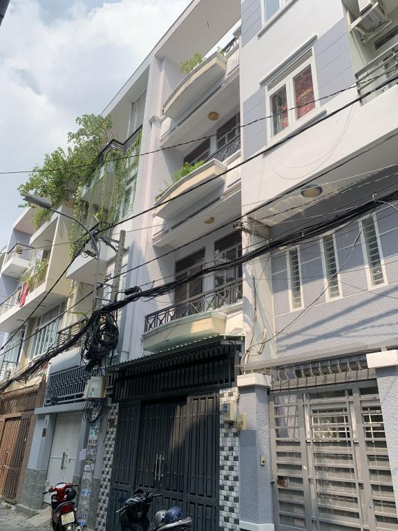 Nhà HXH Đào Duy Anh Quận PN, T_3L, 4PN giá chỉ 18tr/th.